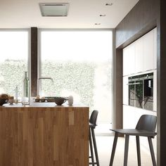 Mano by Kvik is Danish design at its best. This kitchen exudes simplicity, form and function – here, with a solid wood worktop. The unique handleless doors and drawers open from top or bottom. That is cool, right? #manobykvik #danishdesign #nordicinterior #coolkitchen #greatdesign #kvik #decorate #interior #homeliving #interiordesign #Scandinaviandesign #welovekitchens #smartthinking #home #design #trend #stylish #kitchentrends