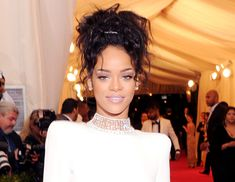 "@Byrdie Beauty - Rihanna    Messy topknot, anyone? The singer went against the grain, sporting a messy up-do to offset the polished look of her neutral makeup. Makeup artist Mylah Morales shared the secret to the Rihanna's flawless complexion: vbeauté's Buying Time ($53), a nourishing everyday cream, and vbeauté's Undercover Agent ($45), an anti-wrinkle serum that binds moisture to the skin. ""I wanted to give her a clean, glowy face to match the clean lines of her dress,"" she says. ""[These…"