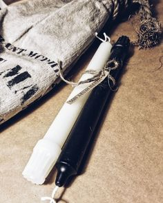 White and charcoal beeswax colonial taper candles. Made in small batches in Red Deer, Alberta, Canada.
