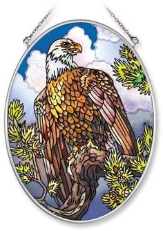 Amia Hand Painted Glass Suncatcher with Eagle Design, 5-1/4-Inch by 7-Inch Oval by Amia. $19.00. Comes boxed, makes for a great gift. Includes chain. Handpainted glass. Amia glass is a top selling line of handpainted glass decor. Known for tying in rich colors and excellent designs, Amia has a full line of handpainted glass pieces to satisfy your decor needs. Items in the line range from suncatchers, window decor panels, vases, votives and much more.