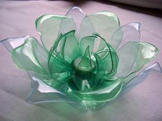 recycled plastic bottles flower by tamas kanya by on DeviantArt recycled plastic bottles flower by on deviantART Water Bottle Crafts, Plastic Bottle Crafts, Plastic Spoons, Diy Bottle, Recycle Plastic Bottles, Plastic Bottle House, Plastic Bottle Flowers, Recycled Bottles, Recycled Crafts