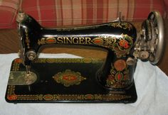 This is a Singer model 66 with the 'Red Eye' or 'Red Head' decals. Serial # G6969592~manufactured in 1919.