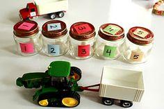 Rij met de tractor naar het juiste potje en leg het in het doosje