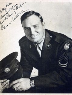 """Gene Autry (1907-1998). U.S. Army Air Force WW II. Enlisted 1942. As a pilot and Technical Sgt. he ferried fuel, ammunition, and arms in the China-India-Burma theater of war flying over the hazardous Himalayan air route, """"The Hump."""" He also volunteered his talents as an entertainer for numerous Air Force shows. He had his own radio show entitled """"Sargeant Gene Autry.""""  When the war ended, he was reassigned to Special Services where he toured with a USO troupe in the South Pacific until 1946."""