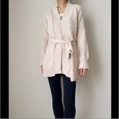 "HPZARA outerwear cardigan Long comfortable material outerwear/ cardigan by ZARA. It comes with the same material color belt. There is a tiny spot ( as per picture) Just thought to let buyers know. It's still a very new cardigan . Never used the belt/ tie ( it comes with it). Measurement arm length 24"" . Overall length 31"" Zara Jackets & Coats"