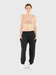 Not your average running pants--these Joggers are not only super cozy but have a modern fit. Designed with a fitted ankle and loose leg these are flattering on any body type. Pair it with the Miakoda Crop Top for a fashion girl's lazy day. * Fit: Loose through thigh with fitted ankle.