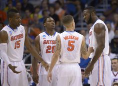 Florida's Will Yeguete Michael Frazier II and Scottie Wilbekin speak to Patric Young during the second half in a second-round game against Albany in the NCAA college basketball tournament Thursday, March in Orlando, Fla. (AP Photo/Phelan M. Sec Football, Football And Basketball, College Basketball, Florida Gators Basketball, Ncaa College, March Madness, Scottie, Orlando, Thursday