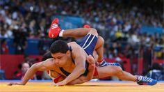 Zaur Kuramagomedov of Russia competes with Tarek Aziz Benaissa of Algeria (top) during their Men's Greco-Roman 60 kg Wrestling 1/8 Final bout on Day 10 of the London 2012 Olympic Games at ExCeL