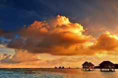 Dramatic sunrise over the sea at one tropical resort in Maldives.