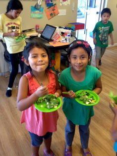 Kids smile over salad in the Learn Your Fruits and Vegetables Program!