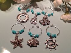 Check out this item in my Etsy shop https://www.etsy.com/listing/201678098/ocean-wine-charms-beaded-wine-charms