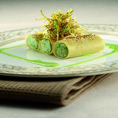 Paccheri ripieni con crema di Grana Padano e asparagi selvatici con salsa ai porri