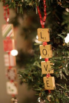 Got an old Scrabble game you never play? Upcycle the pieces into word ornaments with wire, beads, a drill and scrapbook paper. Learn more at Things That Are Pretty.