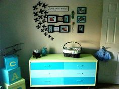 My baby room I designed turquoise lime green nursery madhatter decor quotes pictures painted midcentury modern dresser painted wood blocks