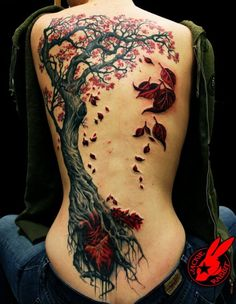 "The Heart Tree Tattoo Jackie Rabbit, an artist in Roanoke, Virginia, made this crisp and striking tattoo. She calls it the ""Heart Tree."" The blood of the long buried heart flows up into the living tree, emerges as leaves before falling down to the ground in death.  - story via Neatorama"