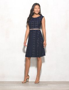 Because we all need that dress that makes the cubicle-to-cocktails transition as easy as possible. Keep this fit-and-flare simple with pumps and a cardi by day, then give it some more glamour with a statement necklace after five. Removable belt. Imported.