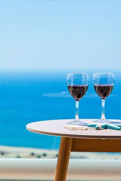 Enjoy a glass of  wine with perfect  sea view from our  luxury Villas 30ecca20069