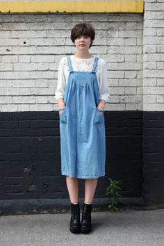 the whitepepper. denim pinafore dress, white lace top and black lace up boots.