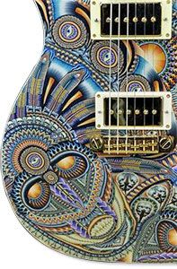 John Anderson is the world master in polymer clay cane work. I always wanted to cover a guitar and now he's done it. They are stunning.