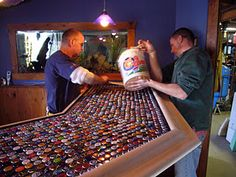 bottle cap bar top...Such a great idea for a basement bar top.
