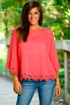 This coral poncho has some amazing crochet details! The flowy fit will keep you cool and perfect to pair with denim, maxi, or whatever you like! You will look spectacular in this gorgeous color!