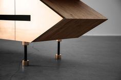 Designer media cabinet - sharp angles and triangles expressed in precious materials - solid oak wood and thick copper