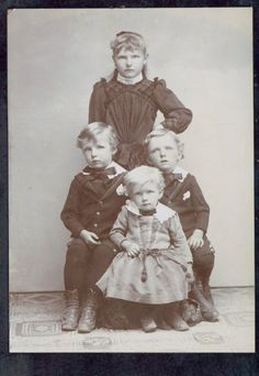 Children of John and Margaretha Sievers.  Top: Anna born in 1886  Middle: John born in 1887 on the left and Otto born 1889 on the right.  Front: Henry born in 1891  DPL Archives #2005.18.170