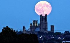 A full moon hangs over Ely Cathedral in Cambridgeshire