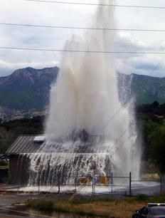 A malfunction in a drinking water well had the appearance of a geyser shooting water straight through the top of a building Monday