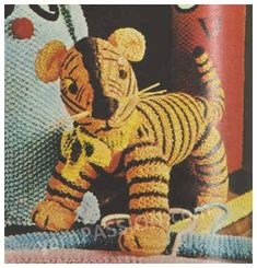Tiger knitted toy pattern can be found at Etsy shop called YarnPassionDesigns