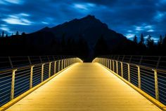 Pedestrian bridge over the river Banff by StructurCraft #WoodLovers #architecture #bridge