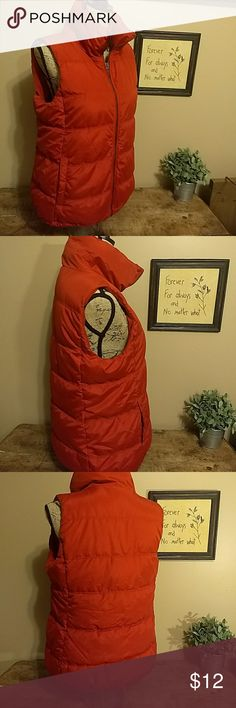 Ladies Old Navy Medium puffer vest Very cute pumpkin colored Old Navy puffer vest. Ladies size medium. Zipper front and two pockets. In great condition. From a smoke-free and pet-free home. Old Navy Jackets & Coats Vests