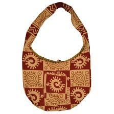 This gorgeous reversible hippie handbag features a striking block print swirl pattern on one side, with a complimentary gecko design on the other. With a patch pocket on both sides, this retro tote is two handbags in one! These huge reversible hippie bags are ideal for carrying groceries or as a general tote. $18.00
