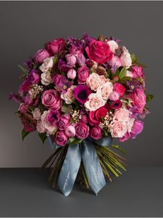 Perfectly Pink Bouquet. A gorgeous and feminine mix of pink roses and spray roses, clematis, anemones and seasonal foliage
