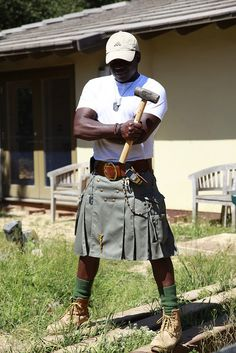 Not often do you a person wearing a baseball cap with a kilt.