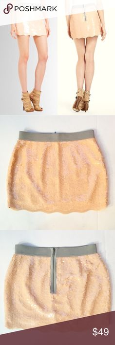 "🆕BCBGMaxAzria Scalloped Hem Sequin Mini Skirt Authentic BCBGMaxAzria ""Michaela"" mini skirt. Gorgeous rose pink color with gray waistband. Like new condition, has been hanging in my closet unworn for a year (minor hanger indentations that will fade, not noticeable when wearing) Features scalloped hemline and elastic waistband. Back zip w/hook & eye closure. Size XS, approx 13.5 across waist lying flat, 14"" long. Model photos credit Lord and Taylor. ❌No trades❌Price firm unless bundled…"