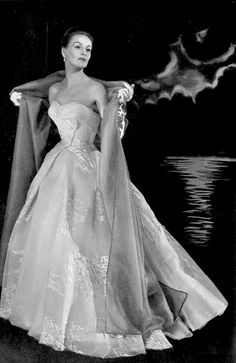 1964 Model in beautiful embroidered white organdy gown with sky blue organza stole by Givenchy, photo by Georges Saad