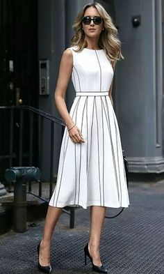 white pleated sleeveless a-line midi dress with black piping illusion pleats classic summer style perfect for the office or any special event Nyc Fashion, Fashion Over, Look Fashion, Womens Fashion, Fashion News, Stylish Dresses, Simple Dresses, Fashion Dresses, Classic Dresses