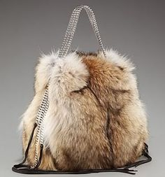 Christian Louboutin Marianna Rider fur Tote..DISCUSTING. I would never buy anthing made from animal fur.