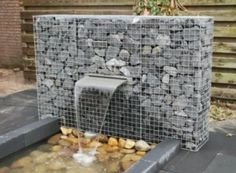 Gabion design ideas | GardenDrum  Gabion blade fountain by Gabion Schanskorven Nederland