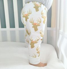 These adorable pants feature Deer with beautiful floral headpieces. The deer appear to be sparkly but are actually just made to look that way with no glitter. These leggings are made out of a lightwei