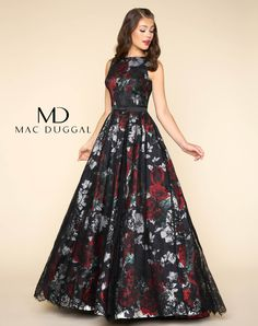 Sleeveless, boat neck, floor length, fit and flare ball gown in a black floral print with lace applique and satin belt.