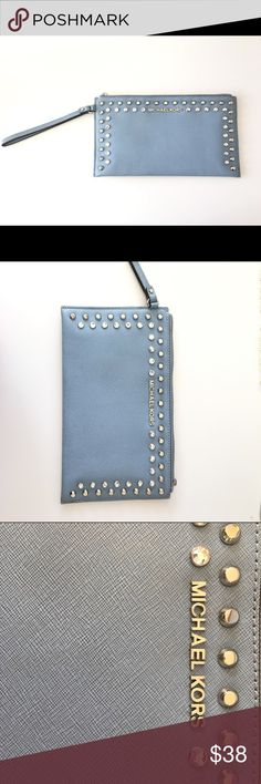 Micheal Kors Light Blue Saffiano Leather Wristlet Micheal Kors Light Blue Saffiano Leather Wristlet   Store Display Missing Zipper Pull (see photo) 6 Card Slots 1 Large Slot Embellished with polished studs and rhinestones this Micheal Kors wristlet is an edgy take on the classic clutch. Cut from saffiano leather, it fastens with a convenient top-zip closure and easily stows your phone, cards, lipstick and more. Toss it into your carryall or enlist the wristlet strap for evening fun. Michael…
