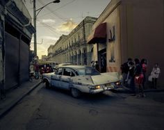 Joakim Eskildsen for TIME An aging car drives through Old Havana at dusk.