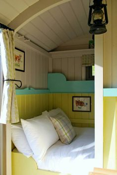 I've seen a lot of tiny house plans, and this is the 1st with beds tucked into an alcove of the kitchen - to benefit from the woodstove heat? More photos at the link - it's very cute, love the beadboarding || The America Dream