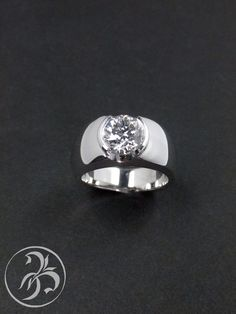 Simple Solitaire with wide band.  Custom Created in 18k white gold by Redford Jewelers in Salt Lake City