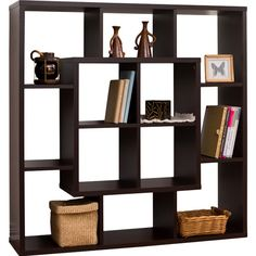 Display a collection of artwork, family heirlooms, or leather-bound tomes with this stylish bookcase, featuring an openwork design in brown....