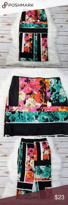 BISOU BISOU Black Stripe Floral Pencil Skirt XS BISOU BISOU XS Black Floral Pencil Skirt. There is a slit up the middle of the back. Waist is 12.5 inches across, unstretched (there is an elastic waistband) and the length is 28 inches.  Thank you for looking and please check out my closet!  B22 Bisou Bisou Skirts Pencil
