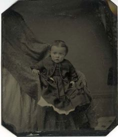 """""""Hidden Mother"""" was a 19th century portrait trend where mothers, who were basically dressed a """"ghost,"""" would hold their young children still while being photographed."""