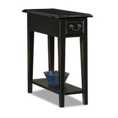 Scaled to fit most anywhere this chairside table features a drawer and display shelf. This attractive table features solid wood construction and a classic black finish.